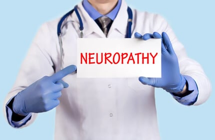 Doctor keeps a card with the name of the diagnosis – neuropathy. Selective focus. Medical concept.