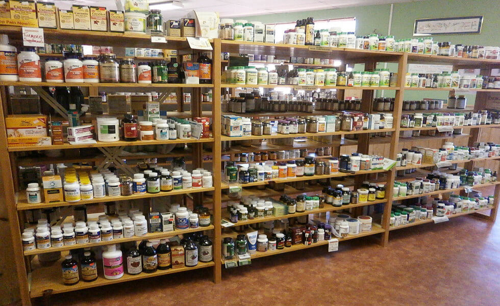 A shelf of herbs and vitamins in a store
