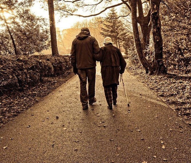 Elderly couple with neuropathy going for a walk